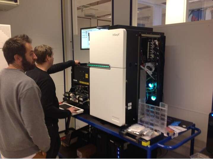 Oslo University Hospital, Illumina service engineers installing new HiSeq X machine